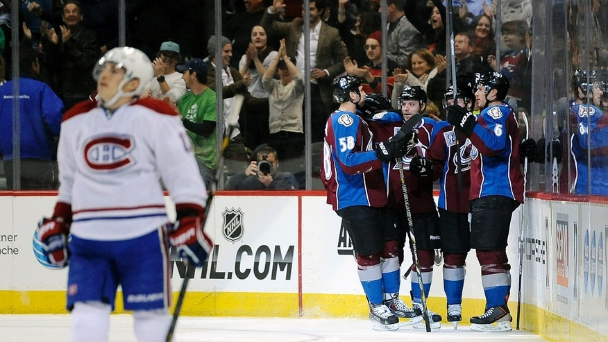 The Colorado Avalanche celebrate a goal by Avalanche left wing Gabriel Landeskog, of Sweden, against the Montreal Canadiens in the second period of an NHL hockey game on Saturday, Nov. 2, 2013, in Denver. (AP Photo/Chris Schneider)