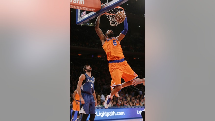 New York Knicks' Tyson Chandler (6) dunks the ball in front of Minnesota Timberwolves' Ricky Rubio (9), of Spain, during the first half of an NBA basketball game Sunday, Nov. 3, 2013, in New York. (AP Photo/Frank Franklin II)