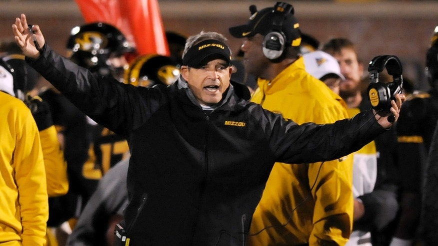 Missouri head coach Gary Pinkel yells on the sidelines during the second half of an NCAA college football game against Tennessee, Saturday, Nov. 2, 2013, in Columbia, Mo. (AP Photo/L.G. Patterson)