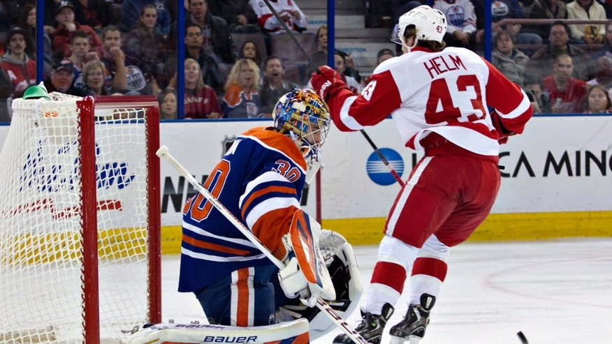 Detroit Red Wings' Darren Helm (43) celebrates a goal on Edmonton Oilers goalie Richard Bachman (30) during the first period of an NHL hockey game Saturday, Nov. 2, 2013, in Edmonton, Alberta. (AP Photo/The Canadian Press, Jason Franson)