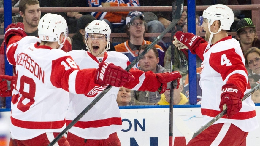Detroit Red Wings' Joakim Andersson (18), Tomas Tatar (21) and Jakub Kindl (4) celebrate a goal against the Edmonton Oilers during the first period of an NHL hockey game Saturday, Nov. 2, 2013, in Edmonton, Alberta. (AP Photo/The Canadian Press, Jason Franson)