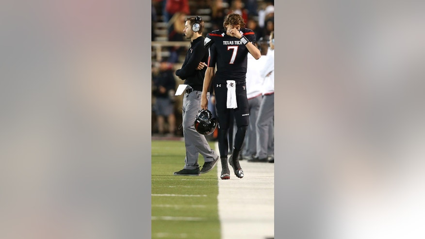 Texas Tech's Davis Webb walks away from head coach Kliff Kingsbury during an NCAA college football game against Oklahoma State, in Lubbock, Texas, Saturday, Nov. 2, 2013. Oklahoma State won 52-34. (AP Photo/Lubbock Avalanche-Journal, Stephen Spillman)