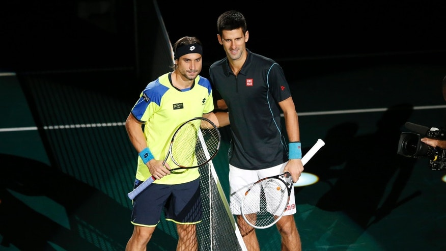 David Ferrer of Spain, left, and Novak Djokovic of Serbia pose prior to their final match, at the Paris Masters tennis at Bercy Arena in Paris, France, Sunday, Nov. 3, 2013. (AP Photo/Francois Mori)