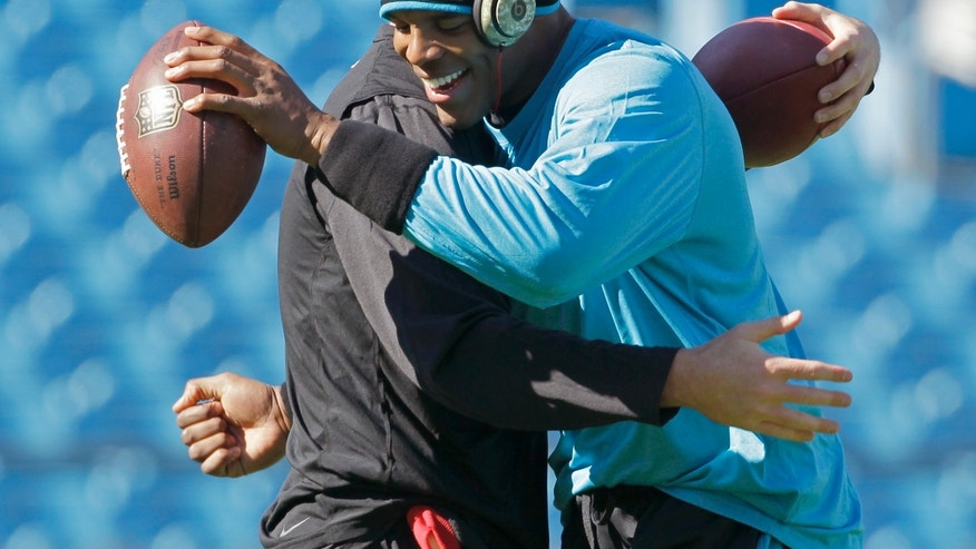 Carolina Panthers quarterback Cam Newton, right, greets Atlanta Falcons quarterback Matt Ryan before an NFL football game in Charlotte, N.C., Sunday, Nov. 3, 2013. (AP Photo/Bob Leverone)