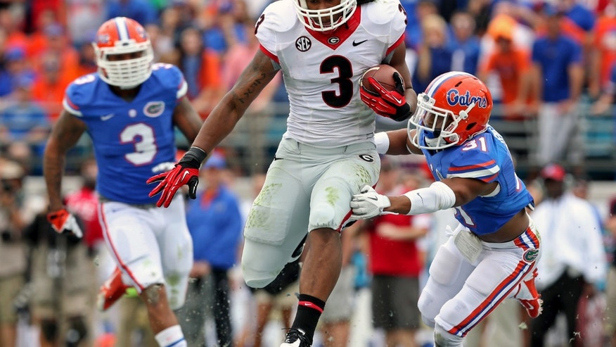 Georgia running back Todd Gurley (3) runs past Florida defensive back Cody Riggs (31) for a 73-yard touchdown catch from quarterback Aaron Murray during the first half of an NCAA football game, Saturday, Nov. 2, 2013 at Alltel Stadium in Jacksonville, Fla. (AP Photo/Atlanta Journal-Constitution, Jason Getz)  MARIETTA DAILY OUT; GWINNETT DAILY POST OUT; LOCAL TV OUT; WXIA-TV OUT; WGCL-TV OUT