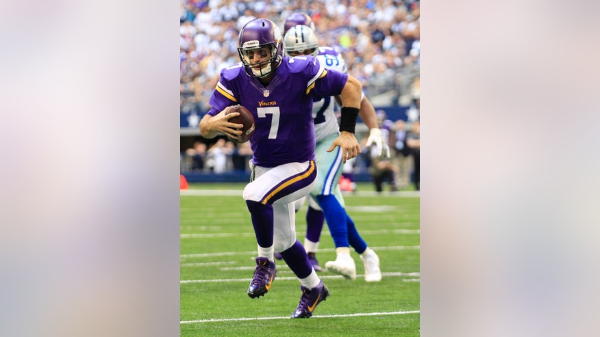 Minnesota Vikings quarterback Christian Ponder runs into the end zone for a score as Dallas Cowboys' Jason Hatcher, rear, watches in the first half of an NFL football game, Sunday, Nov. 3, 2013, in Arlington, Texas. (AP Photo/Tim Sharp)