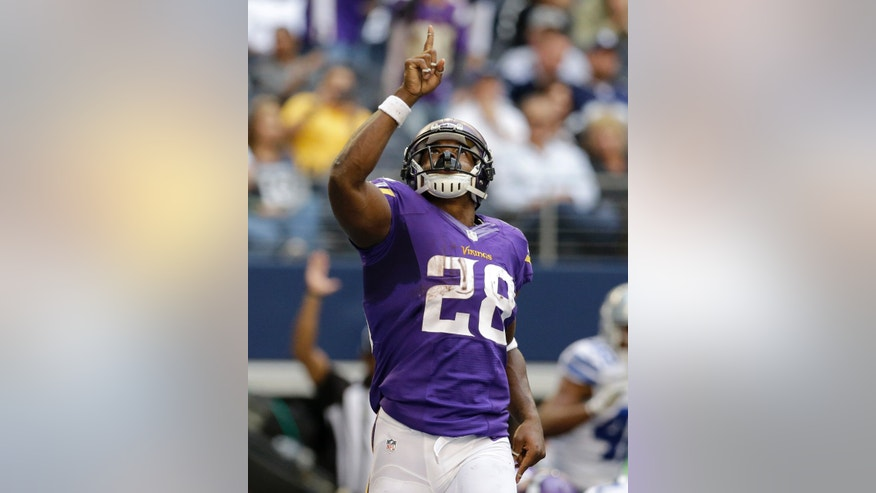 Minnesota Vikings' Adrian Peterson (28) celebrates after quarterback Christian Ponder ran the ball in for a touchdown in the first half of an NFL football game against the Dallas Cowboys, Sunday, Nov. 3, 2013, in Arlington, Texas. (AP Photo/Nam Y. Huh)