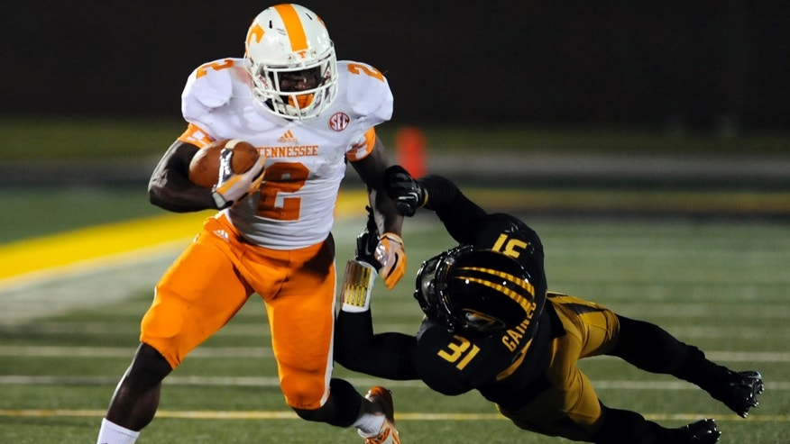 Tennessee wide receiver Pig Howard, left, runs with the ball as Missouri's E.J. Gaines defends during the second half of an NCAA college football game Saturday, Nov. 2, 2013, in Columbia, Mo. (AP Photo/L.G. Patterson)