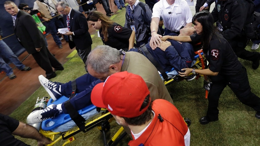 Houston Texans head coach Gary Kubiak is taken off the field on a stretcher during the second quarter of an NFL football game against the Indianapolis Colts, Sunday, Nov. 3, 2013, in Houston. (AP Photo/David J. Phillip)