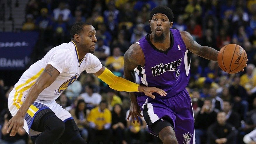 Sacramento Kings' John Salmons, right, drives the ball past Golden State Warriors' Andre Iguodala during the first half of an NBA basketball game on Saturday, Nov. 2, 2013, in Oakland, Calif. (AP Photo/Ben Margot)