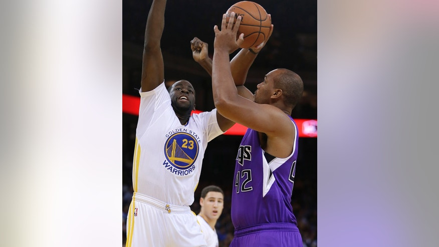 Sacramento Kings' Chuck Hayes, right, shoots against Golden State Warriors' Draymond Green during the first half of an NBA basketball game on Saturday, Nov. 2, 2013, in Oakland, Calif. (AP Photo/Ben Margot)