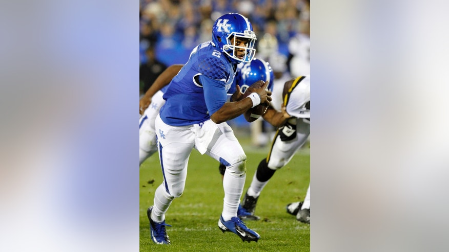 Kentucky's Jalen Whitlow rushes up the field during the second quarter of an NCAA college football game against Alabama State, Saturday, Nov. 2, 2013, in Lexington, Ky. (AP Photo/James Crisp)