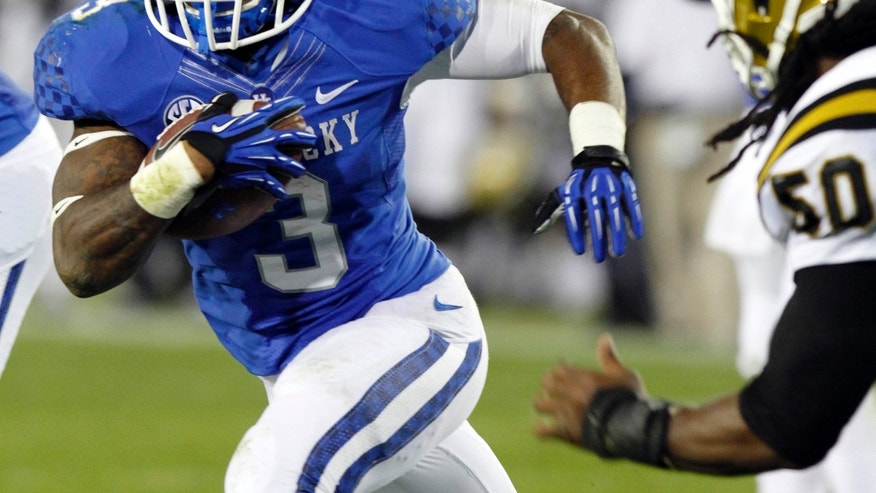 Kentucky's Jojo Kemp, left, runs around Alabama State's Leland Baker for a touchdown during the second quarter of an NCAA college football game Saturday, Nov. 2, 2013, in Lexington, Ky. (AP Photo/James Crisp)