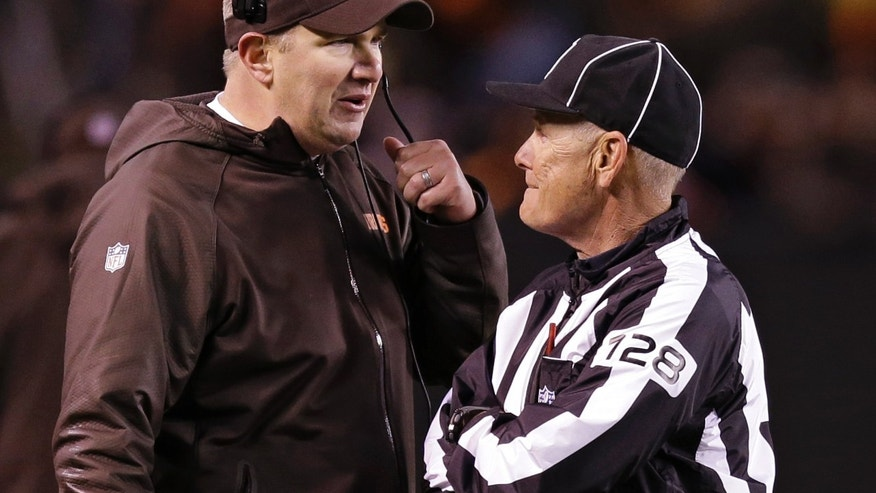 Cleveland Browns head coach Rob Chudzinski talks with side judge Larry Rose (128) in the third quarter of an NFL football game against the Baltimore Ravens Sunday, Nov. 3, 2013, in Cleveland. (AP Photo/Tony Dejak)