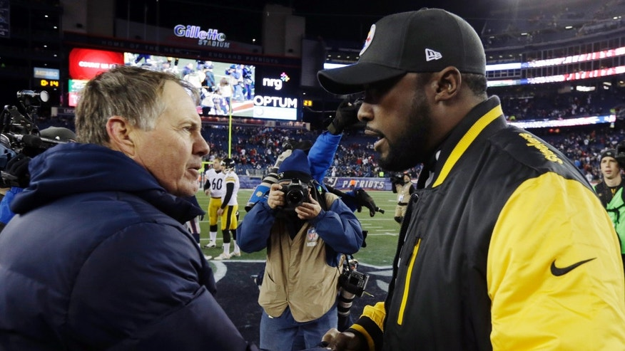 New England Patriots head coach Bill Belichick, left, speaks to Pittsburgh Steelers head coach Mike Tomlin after an NFL football game Sunday, Nov. 3, 2013, in Foxborough, Mass. The Patriots won 55-31.  (AP Photo/Steven Senne)