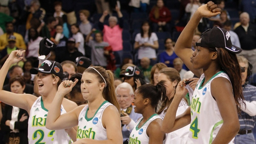 FILE - In this April 2, 2013 file photo, Notre Dame players celebrate an 87-76 win over Duke at the regional final of the NCAA women's college basketball tournament in Norfolk, Va. Notre Dame has been to three straight Final Fours as it enters the Atlantic Coast Conference. The Fighting Irish are determined to start their ACC tenure by dethroning Duke, who has won three of the past four league titles. (AP Photo/Steve Helber, File)
