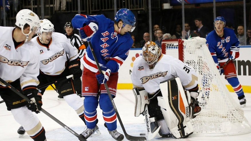 New York Rangers center Derick Brassard (16) takes a shot but misses as Anaheim Ducks goalie Frederik Andersen (31) of Denmark defends in the second period of their NHL hockey game at Madison Square Garden in New York, Monday, Nov. 4, 2013.  (AP Photo/Kathy Willens)