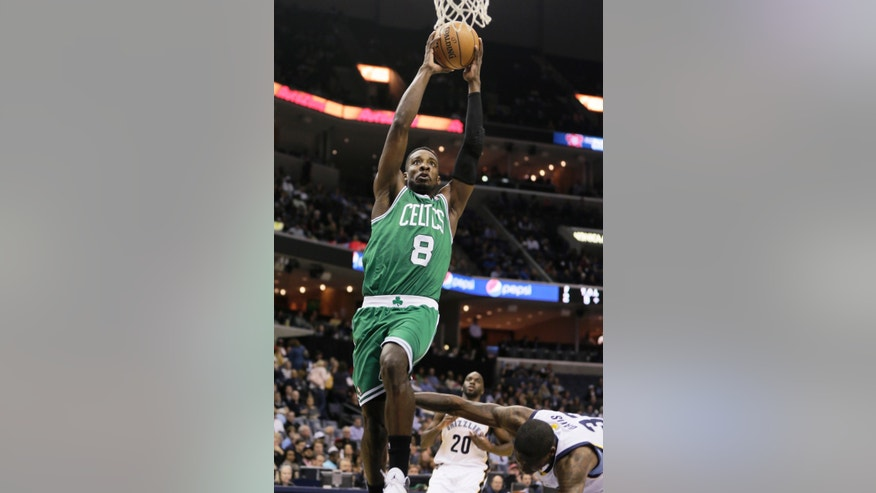 Boston Celtics' Jeff Green (8) goes to the basket over Memphis Grizzlies' Ed Davis, right, as Memphis Grizzlies' Quincy Pondexter (20) watches in the first quarter of an NBA basketball game in Memphis, Tenn., Monday, Nov. 4, 2013. (AP Photo/Danny Johnston)