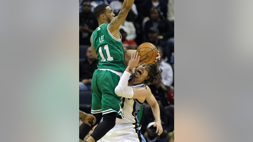 Memphis Grizzlies' Mike Miller, right, collides with Boston Celtics' Courtney Lee (11) during the first quarter of an NBA basketball game in Memphis, Tenn., Monday, Nov. 4, 2013. (AP Photo/Danny Johnston)