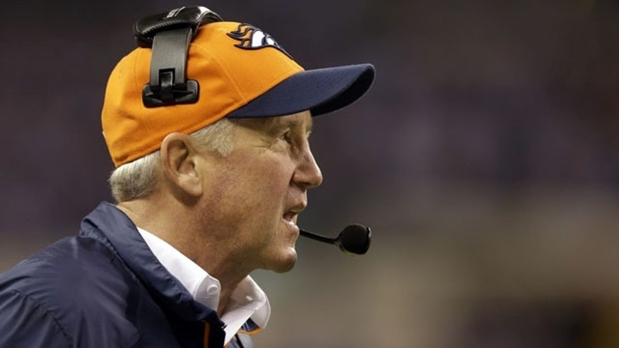 Denver Broncos head coach John Fox watches during the first half of an NFL football game against the Indianapolis Colts, Sunday, Oct. 20, 2013, in Indianapolis. (AP Photo/Michael Conroy)