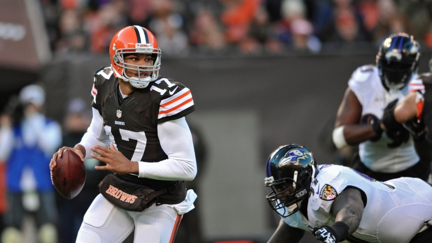 Cleveland Browns quarterback Jason Campbell (17) scrambles before being sacked by the Baltimore Ravens in the first quarter of an NFL football game Sunday, Nov. 3, 2013. (AP Photo/David Richard)
