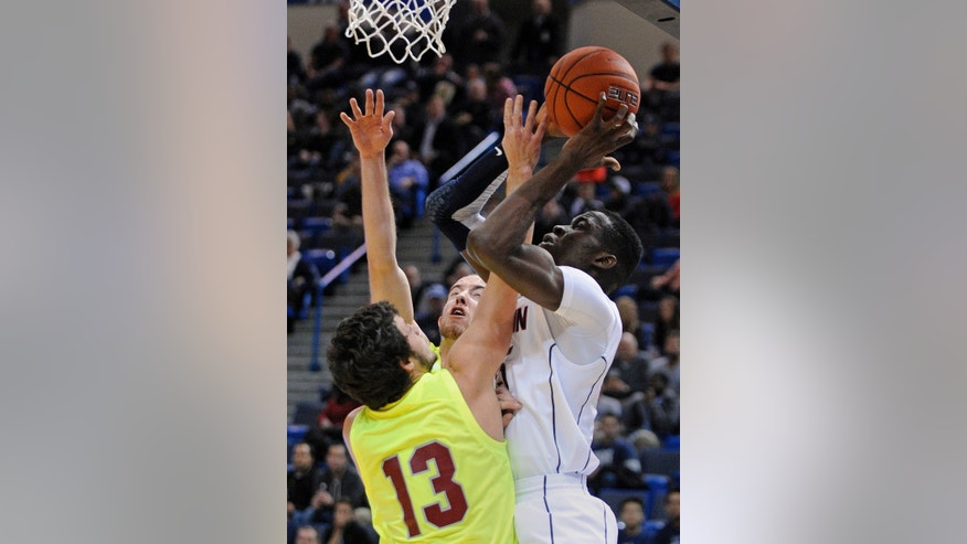 Connecticut's Amida Brimah, right is defended by Concordia's Mike Walmer during the first half of an NCAA college basketball game, in  Hartford, Conn., on Saturday, Nov. 4, 2013. (AP Photo/Fred Beckham)