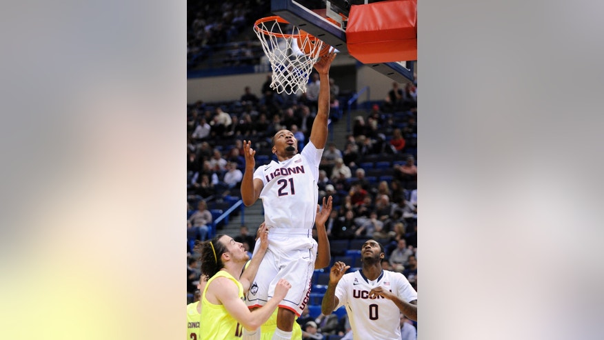 Connecticut's Omar Calhoun scores two points during the first half of an NCAA college basketball game against Concordia, in  Hartford, Conn., on Saturday, Nov. 4, 2013. (AP Photo/Fred Beckham)