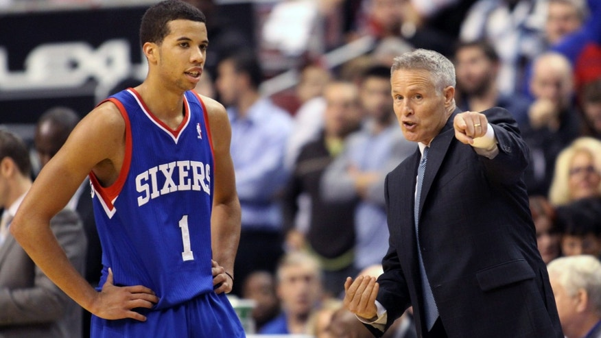 Philadelphia 76ers coach Brett Brown speaks to Michael Carter-Williams (1) as they play the Chicago Bulls in the second  half of an NBA basketball game Saturday Nov. 2, 2013, in Philadelphia. The 76ers won 107-104. (AP Photo/H. Rumph Jr)