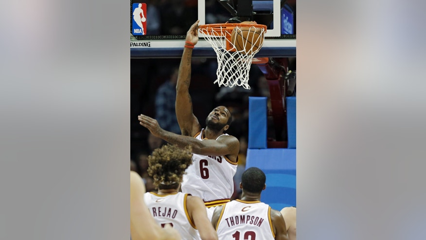 Cleveland Cavaliers' Earl Clark (6) dunks against the Minnesota Timberwolves in the first quarter of an NBA basketball game Monday, Nov. 4, 2013, in Cleveland. (AP Photo/Mark Duncan)