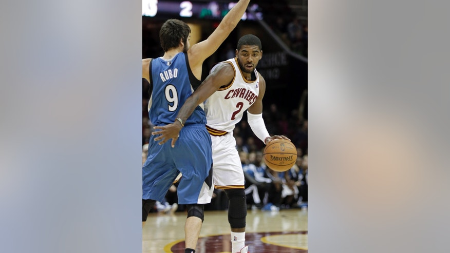 Cleveland Cavaliers' Kyrie Irving (2) tries to get past Minnesota Timberwolves' Ricky Rubio (9), from Spain, in the second quarter of an NBA basketball game Monday, Nov. 4, 2013, in Cleveland. (AP Photo/Mark Duncan)