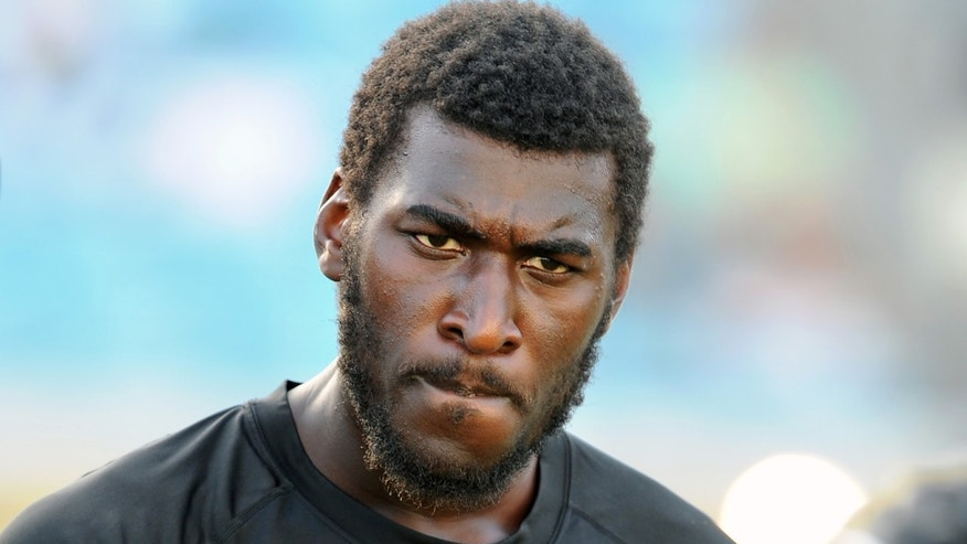 FILE - In this Aug. 9, 2013 file photo, Jacksonville Jaguars wide receiver Justin Blackmon speaks with a teammate during warmups before an NFL preseason football game against the Miami Dolphins, in Jacksonville, Fla. Blackmon was suspended for the rest of the season Friday, Nov. 1, 2013, for another violation of the NFL's substance-abuse policy.  (AP Photo/Stephen Morton, File)