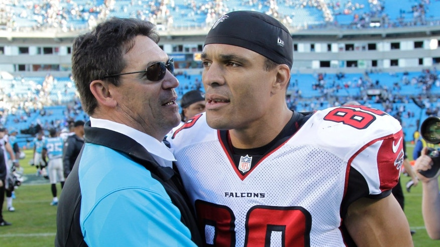 Carolina Panthers head coach Ron Rivera, left, talks with Atlanta Falcons' Tony Gonzalez, right, after an NFL football game in Charlotte, N.C., Sunday, Nov. 3, 2013. The Panthers won 34-10. (AP Photo/Bob Leverone)
