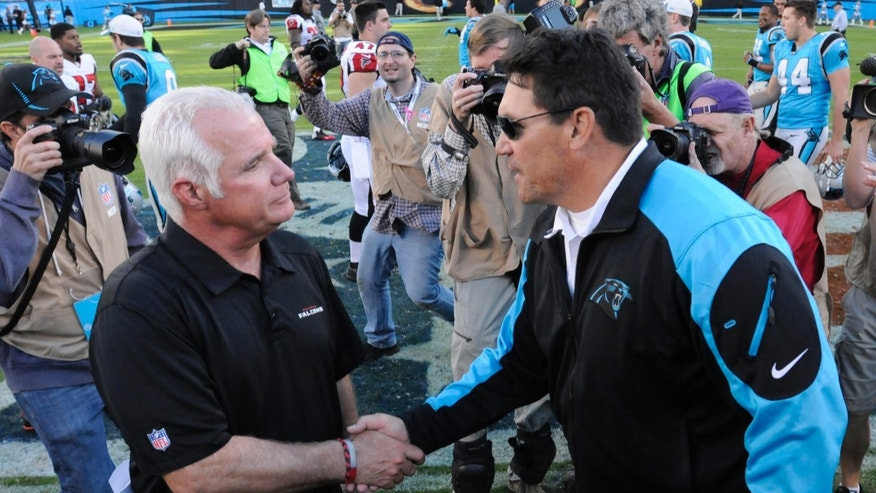 Carolina Panthers head coach Ron Rivera, right, shakes hands with Atlanta Falcons head coach Mike Smith after an NFL football game in Charlotte, N.C., Sunday, Nov. 3, 2013. The Panthers won 34-10. (AP Photo/Mike McCarn)