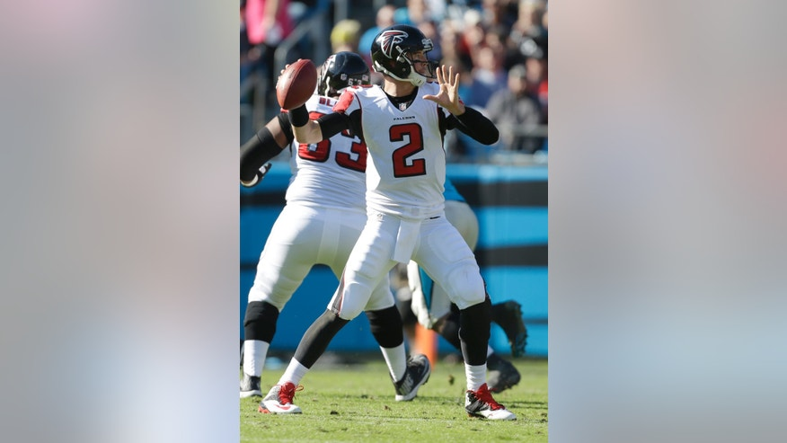 Atlanta Falcons quarterback Matt Ryan (2) looks to pass against the Carolina Panthers in the first half of an NFL football game in Charlotte, N.C., Sunday, Nov. 3, 2013. (AP Photo/Bob Leverone)