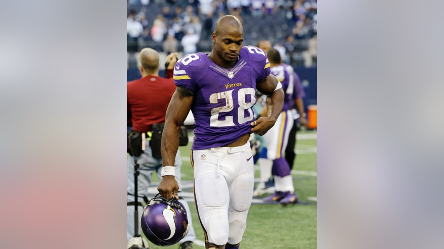 Minnesota Vikings' Adrian Peterson (28) walks off the field following their 27-23 loss to the Dallas Cowboys in an NFL football game, Sunday, Nov. 3, 2013, in Arlington, Texas. (AP Photo/Nam Y. Huh)