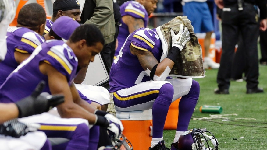 Minnesota Vikings' A.J. Jefferson (24) covers his head with a towel as time winds down in the second half of an NFL football game against the Dallas Cowboys, Sunday, Nov. 3, 2013, in Arlington, Texas. (AP Photo/Nam Y. Huh)