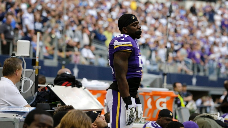 Minnesota Vikings' Larry Dean watches from the top of the bench as the final seconds of the second half wind down in an NFL football game against the Dallas Cowboys, Sunday, Nov. 3, 2013, in Arlington, Texas. (AP Photo/Nam Y. Huh)