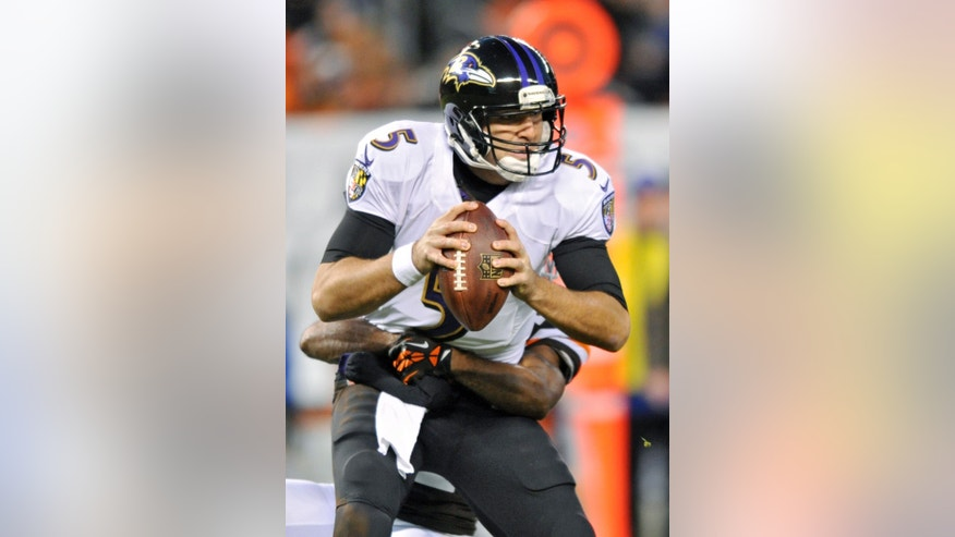 Baltimore Ravens quarterback Joe Flacco (5) is sacked by Cleveland Browns cornerback Chris Owens in the second quarter of an NFL football game Sunday, Nov. 3, 2013. (AP Photo/David Richard)