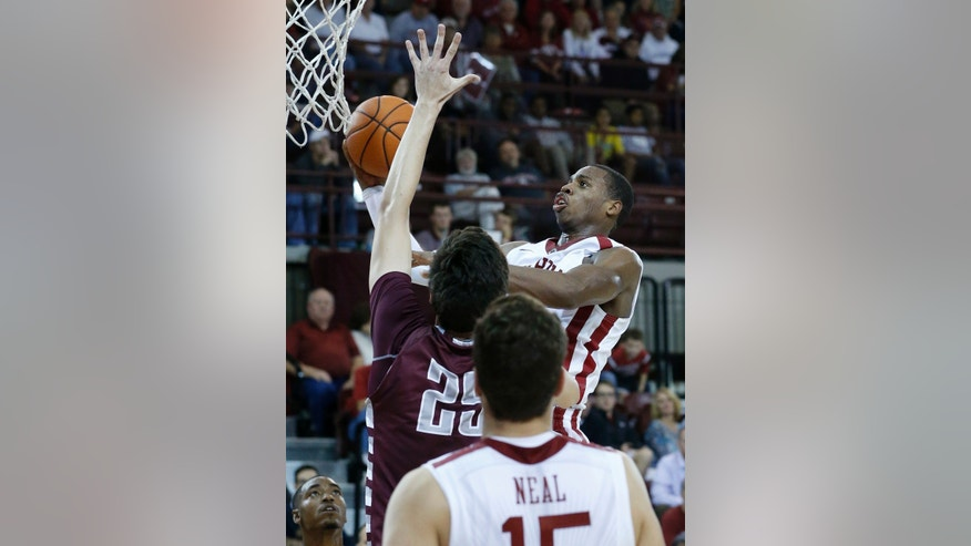 Oklahoma  guard Buddy Hield (24) shoots in front of Oklahoma Christian's John Moon (25) in the second half of an NCAA college basketball exhibition game in Norman, Okla., Monday, Nov. 4, 2013. Oklahoma won 88-76. (AP Photo/Sue Ogrocki)