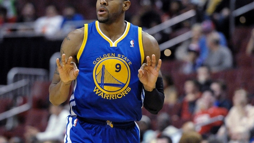 Golden State Warriors' Andre Iguodala celebrates after making a three-point basket during the first half of an NBA basketball game against the Philadelphia 76ers on Monday, Nov. 4, 2013, in Philadelphia. (AP Photo/Michael Perez)