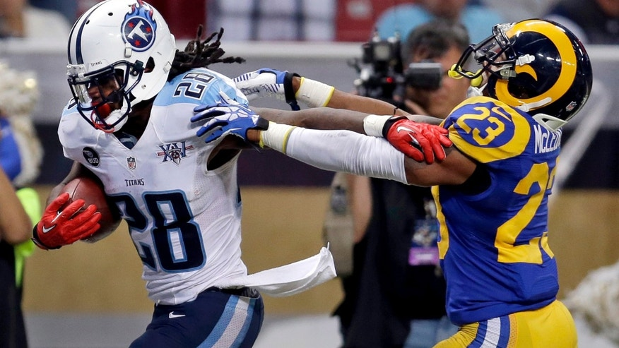 Tennessee Titans running back Chris Johnson (28) scores on a 19-yard run past St. Louis Rams safety Rodney McLeod (23) during the fourth quarter of an NFL football game Sunday, Nov. 3, 2013, in St. Louis. (AP Photo/Jeff Roberson)