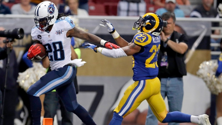 Tennessee Titans running back Chris Johnson, left, scores on a 19-yard run past St. Louis Rams safety Rodney McLeod (23) during the second half of an NFL football game Sunday, Nov. 3, 2013, in St. Louis. (AP Photo/Jeff Roberson)