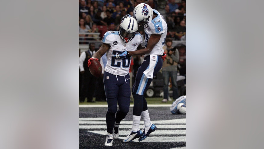 Tennessee Titans running back Chris Johnson, left, is congratulated by Justin Hunter after scoring on a 14-yard run during the third quarter of an NFL football game against the St. Louis Rams, Sunday, Nov. 3, 2013, in St. Louis. (AP Photo/Tom Gannam)