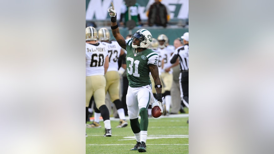 New York Jets' Antonio Cromartie (31) celebrates after an interception during the first half of an NFL football game against the New Orleans Saints Sunday, Nov. 3, 2013, in East Rutherford, N.J.  (AP Photo/Bill Kostroun)