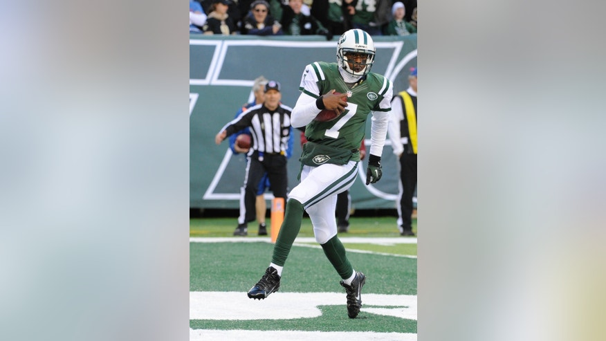 New York Jets quarterback Geno Smith (7) reacts after rushing for a touchdown during the first half of an NFL football game against the New Orleans Saints Sunday, Nov. 3, 2013, in East Rutherford, N.J.  (AP Photo/Bill Kostroun)