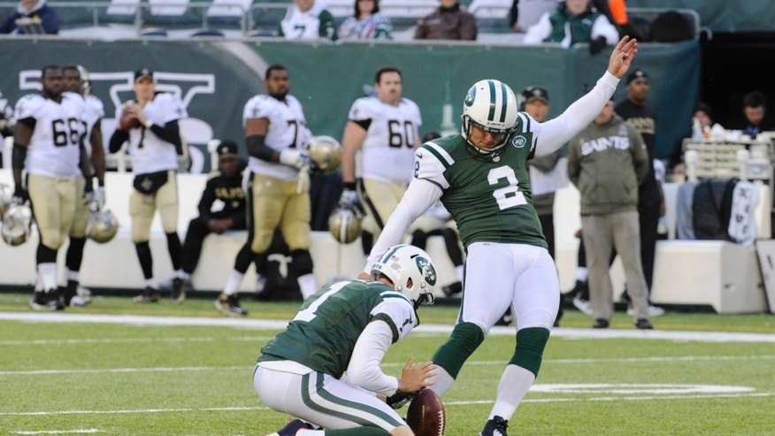 New York Jets kicker Nick Folk (2) kicks a field goal during the second half of an NFL football game against the New Orleans Saints Sunday, Nov. 3, 2013, in East Rutherford, N.J.  (AP Photo/Bill Kostroun)