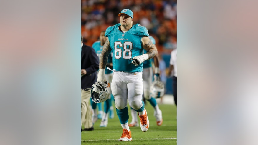 In this photo from Thursday, Oct. 31, 2013, Miami Dolphins guard Richie Incognito (68) walks across the field for the second half of an NFL football game against the Cincinnati Bengals,  in Miami Gardens, Fla. The Miami Dolphins suspended  Incognito late Sunday, Nov. 3, 2013,  for misconduct related to the treatment of teammate Jonathan Martin, who abruptly left the team a week ago to receive help for emotional issues. (AP Photo/Wilfredo Lee)