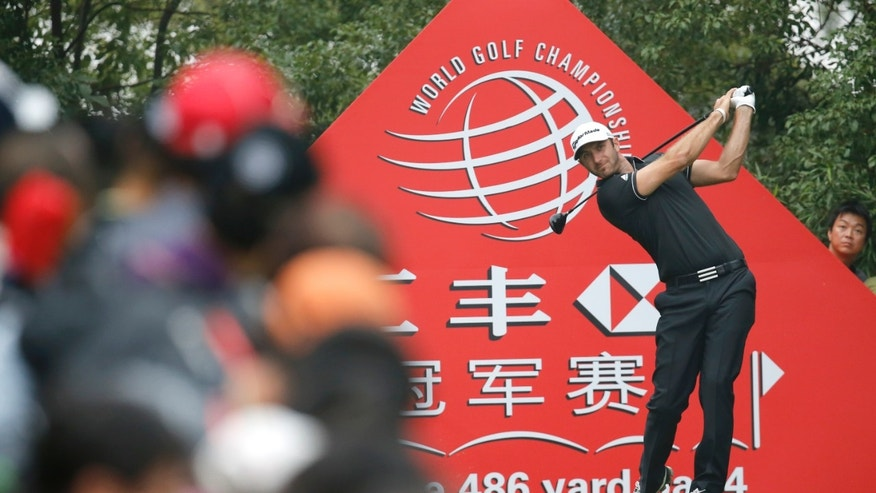 Dustin Johnson of the United States tees off the 9th hole during the final round of the HSBC Champions golf tournament at the Sheshan International Golf Club in Shanghai, China, Sunday, Nov. 3, 2013. Against an all-world cast of contenders,  Johnson pulled away with power and a clutch putt to win his first World Golf Championship on Sunday. (AP Photo/Eugene Hoshiko)