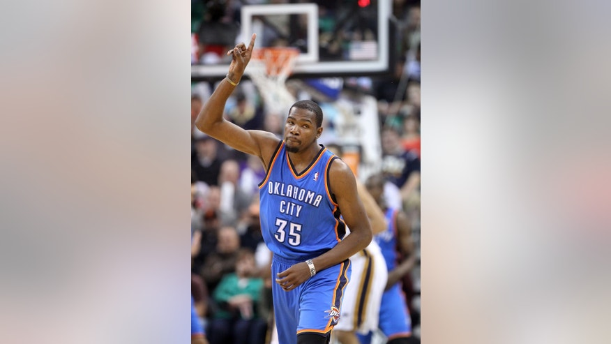 Oklahoma City Thunder's Kevin Durant points skyward after scoring against the Utah Jazz in the second half during an NBA basketball game Wednesday, Oct. 30, 2013, in Salt Lake City. The Thunder won 101-98. (AP Photo/Rick Bowmer)