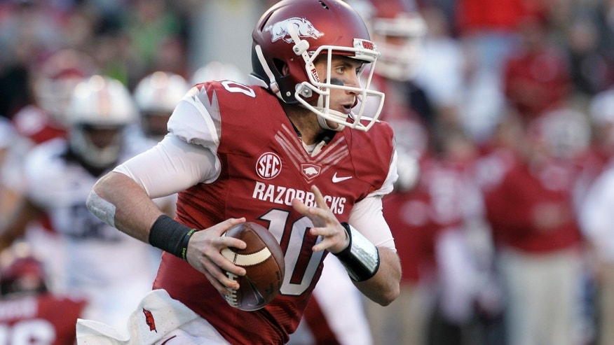Arkansas quarterback Brandon Allen, carries during the second quarter of an NCAA college football game against the Auburn in Fayetteville, Ark., Saturday, Nov. 2, 2013. (AP Photo/Danny Johnston)